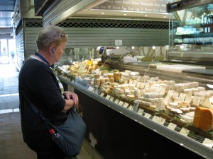 Ginni looking at cheese in the market