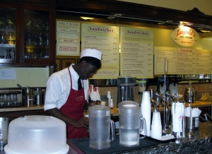 Counter and employee at Leopold's