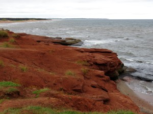High, red cliffs along shore