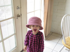 Liking Mama's hat