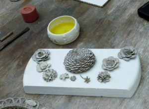Pottery of flowers, stems & leaves