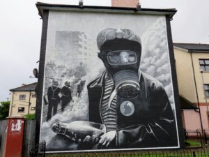 The Petrol Bomber; young boy in a gas mask holding petrol bomb