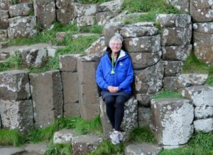 Sarah relaxing among pillars