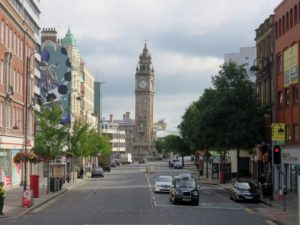 Street view of Belfast with clock tower in background